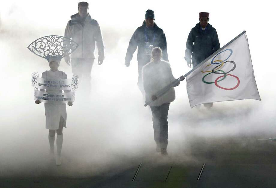 "Olympic participants  attend the Opening Ceremony of the Winter Olympics in Sochi, Russia. To some, the ceremonies delivered a ""whitewashed version"" of Russian history. Photo: Adrian Dennis / Getty Images / AFP"