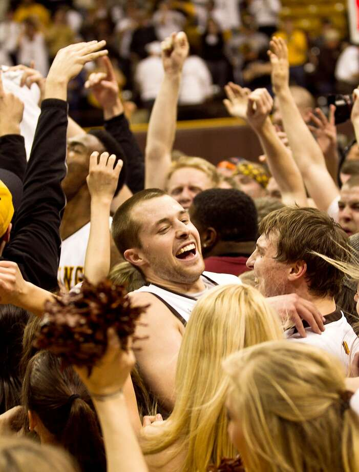 University of Wyoming guard Nathan Sobey (20) celebrates with fans after defeating San Diego State, 68-62 in a mens NCAA basketball game Tuesday, Feb. 11, 2014, at the Arena-Auditorium in Laramie, Wyo.(AP Photo/Jeremy Martin) Photo: JEREMY MARTIN Jeremy Martin, Associated Press