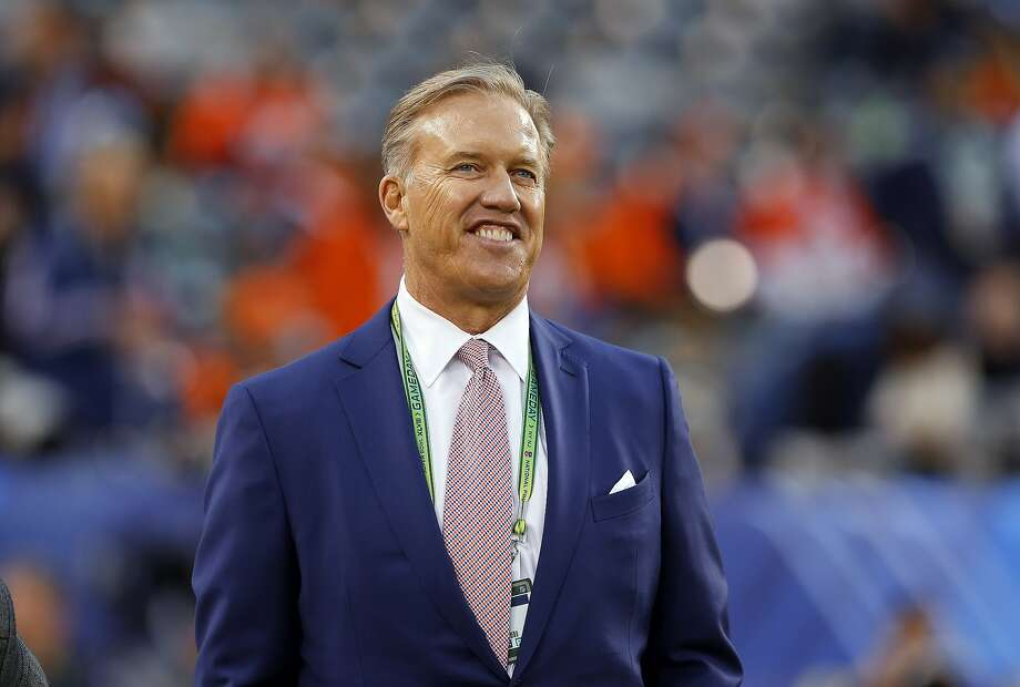 FILE - In this Feb. 2, 2014 file photo, Denver Broncos Executive Vice President of Football Operations John Elway watches during warmups before the NFL Super Bowl XLVIII football game at MetLife Stadium in East Rutherford, N.J. Broncos have extented Elway's contract for three years and added general manager to his title. (AP Photo/Paul Sancya, File) Photo: Paul Sancya, Associated Press