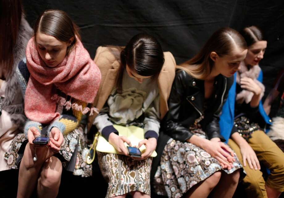 Models wait backstage prior to the J.Crew presentation during Mercedes-Benz Fashion Week Fall 2014 at The Pavilion at Lincoln Center on February 11, 2014 in New York City.  (Photo by Jemal Countess/Getty Images) Photo: Jemal Countess, Getty Images