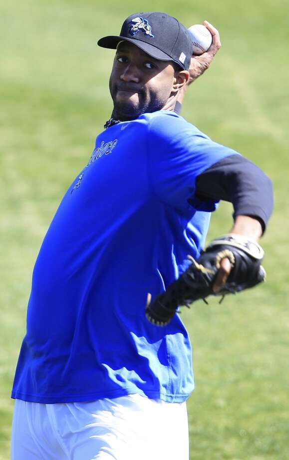 Tracy McGrady warms up by throwing to Koby Clemens at Constellation Field, home of the Sugar Land Skeeters, on Wednesday. Photo: Karen Warren, Houston Chronicle