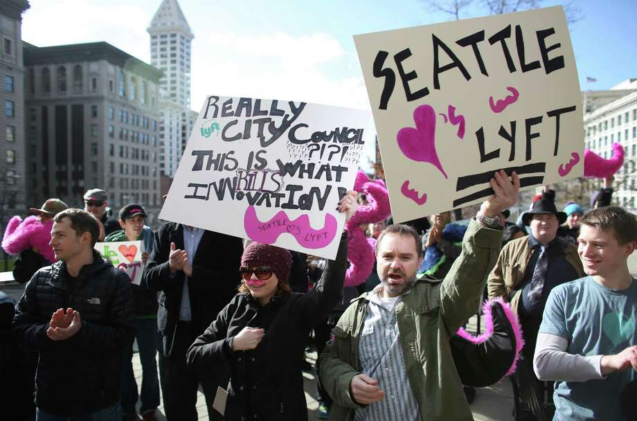 People gather during a rally to support ride-sharing services in Seattle on Wednesday, February 12, 2014. The Seattle City Council is considering regulations for the companies and drivers that provide the service. Photo: JOSHUA TRUJILLO, SEATTLEPI.COM / SEATTLEPI.COM