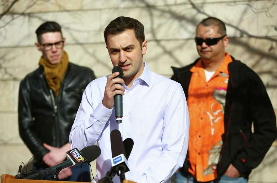 John Zimmer, co-founder of ride-sharing service Lyft, speaks during a rally to support the services in Seattle on Wednesday, February 12, 2014. The Seattle City Council is considering regulations for the companies and drivers that provide the service. Photo: JOSHUA TRUJILLO, SEATTLEPI.COM / SEATTLEPI.COM