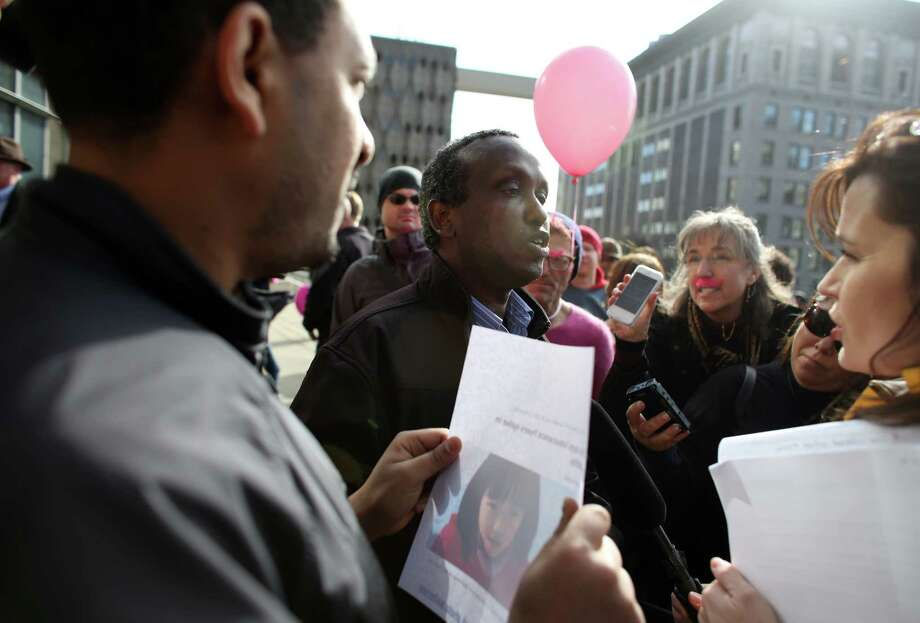 For hire taxi driver Samatar Guled argues about the insurance carried by ride-share drivers during a rally to support ride-sharing services in Seattle on Wednesday, February 12, 2014. The Seattle City Council is considering regulations for the companies and drivers that provide the service. Photo: JOSHUA TRUJILLO, SEATTLEPI.COM / SEATTLEPI.COM