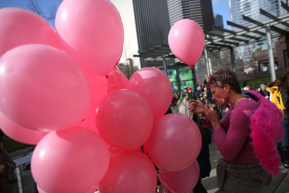 Jeff Landon ties a pink balloon to his wrist during a rally to support ride-sharing services in Seattle on Tuesday, February 12, 2014. The Seattle City Council is considering regulations for the companies and drivers that provide the service. (Joshua Trujillo, seattlepi.com) Photo: JOSHUA TRUJILLO, SEATTLEPI.COM