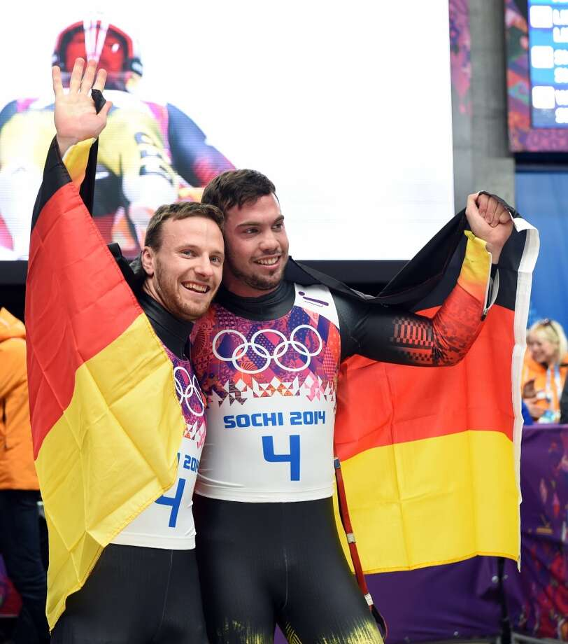Germany's Tobias Arlt and Tobias Wendl celebrates their Gold Medal, Luge Doubles Run 2 at the Sanki Sliding Center during the Sochi Winter Olympics on February 12, 2014. (Leon NealAFP/Getty Images) Photo: LEON NEAL, AFP/Getty Images