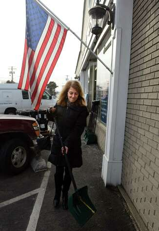 Margo Schiff, of Fairfield, picks up a shovel ahead of the approaching storm Wednesday, Feb. 12, 2014 at Hemlock Hardware on the Post Road in Fairfield, Conn. Photo: Autumn Driscoll / Connecticut Post