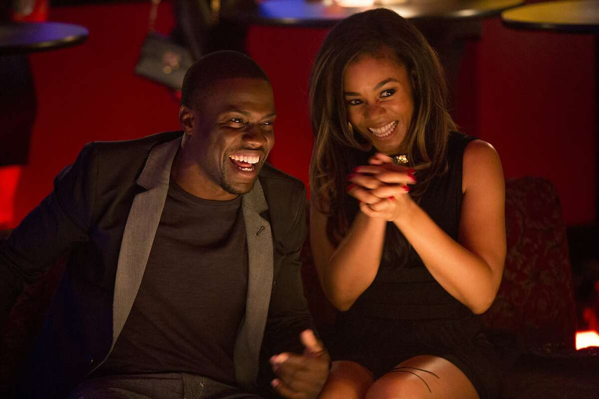 Bernie (Kevin Hart) and Joan (Regina Hall) flirt on their date in Screen Gems' ABOUT LAST NIGHT.