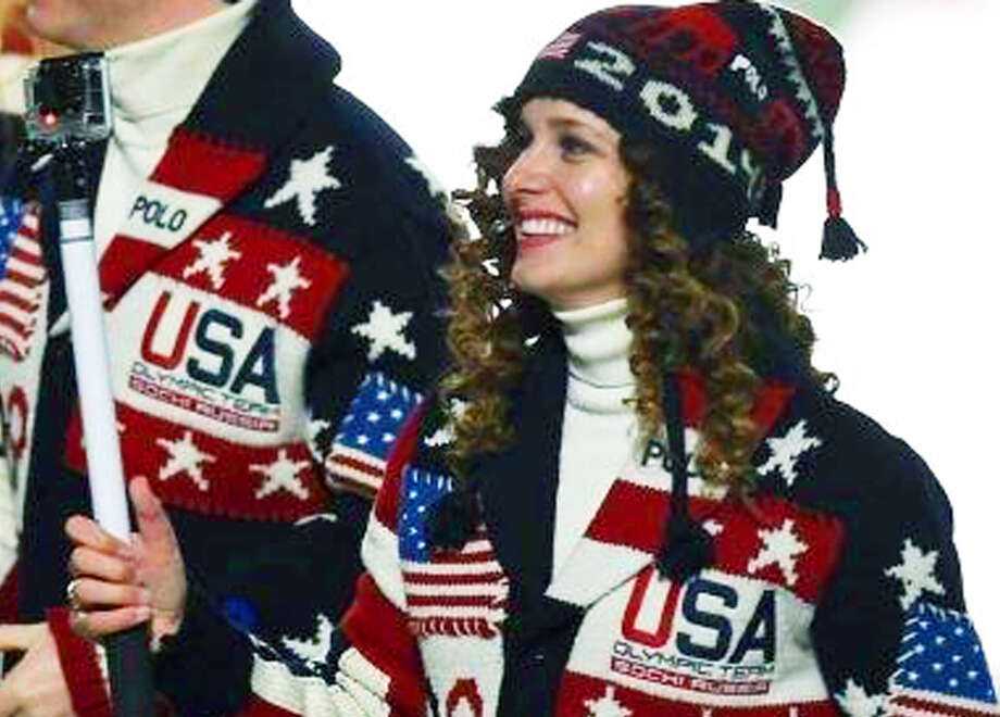 Lindsey Jacobellis of Roxbury sports a broad smile as walks with fellow members of the United States' Winter Olympics team during the opening ceremony for the 2014 Games at Fisht Olympic Stadium in Sochi, Russia, Feb. 7, 2014  Courtesy of  Pascal Le Segretain/Getty Images Photo: Contributed Photo / The News-Times Contributed