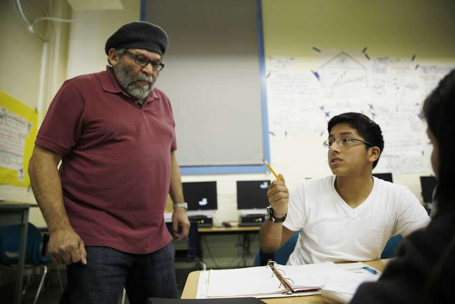 In algebra class, Walter Solórzano (left) first teaches students like eighth-grader Arturo Gomez in their primary language and then in English as part of the Buena Vista Horace Mann K-8 school's dual immersion program in San Francisco. Photo: Lea Suzuki, The Chronicle