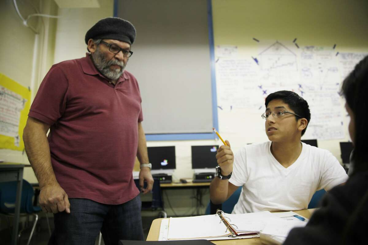 Buena Vista Horace Mann eighth grader Arturo Gomez (right), 13, asks Mr. Walter Solórzano (left) a question during Algebra I class on Tuesday, February 4, 2014 in San Francisco, Calif. Buena Vista Horace Mann has a dual language immersion pathway.
