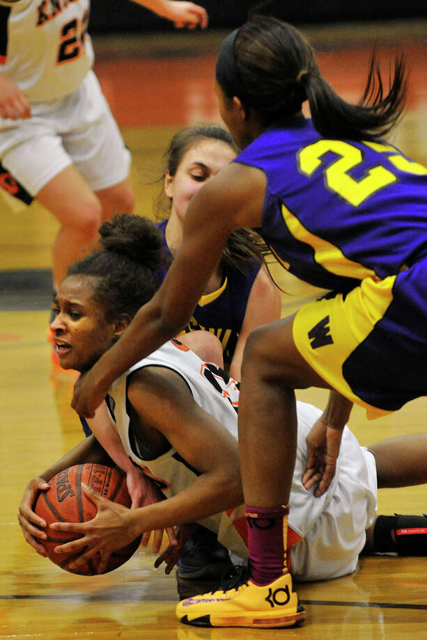 Stamford's Anisa Fortt battles Westhill's Krystal Dixon, right, and Edona Thaqi for control of the loose ball during their basketball game at Stamford High School in Stamford, Conn., on Wednesday, Feb. 12, 2014. Photo: Jason Rearick / Stamford Advocate