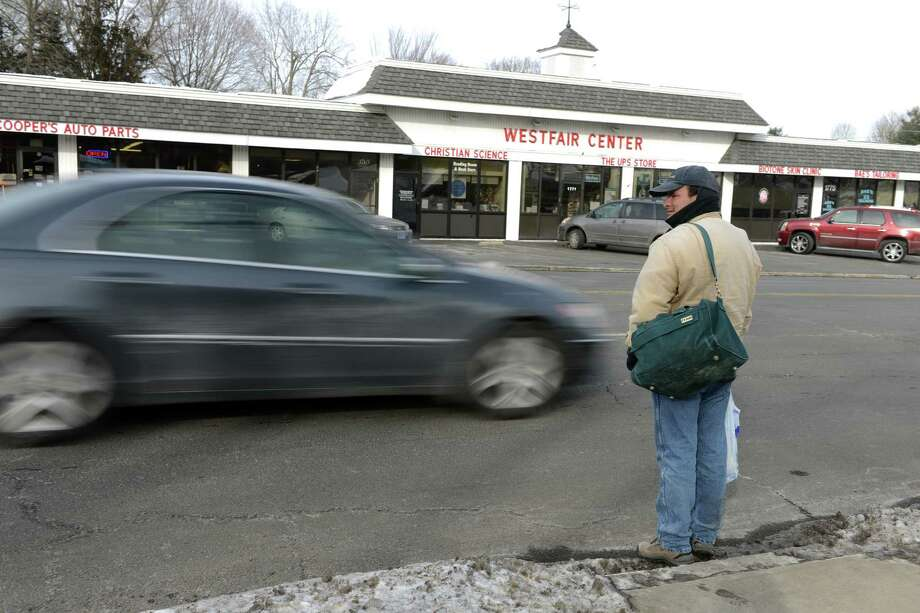 Albert Reyes looks to cross the busy Post Road in front of Stop and Shop in Westport Wednesday, Feb. 12, 2014. For the sixth year in a row, Route 1 along the shoreline was the most dangerous road in Connecticut for pedestrians, according to a new study. Photo: Autumn Driscoll / Connecticut Post