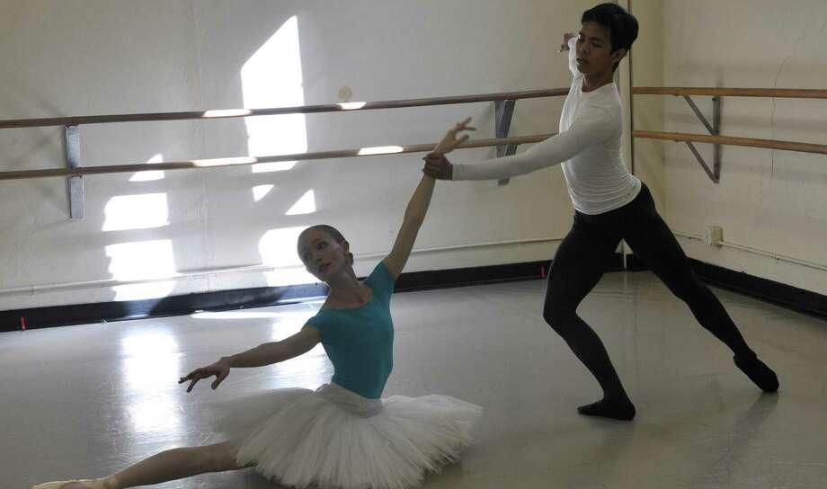 """Ballet San Antonio dancers Sarah Pautz and Jayson Pescasio rehearse """"The Firebird."""" Photo: Courtesy Ballet San Antonio"""