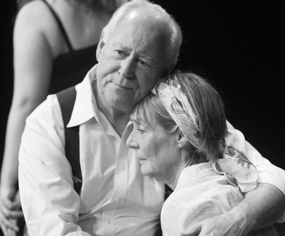 """Willy Loman (Allan S. Ross) comforts his wife Linda (Terri Pena Ross) while being haunted by a Woman (Meredith Bell Alvarez) from his past in Classic Theatre's staging of """"Death of a Salesman."""" Photo: Courtesy Dwayne Green"""