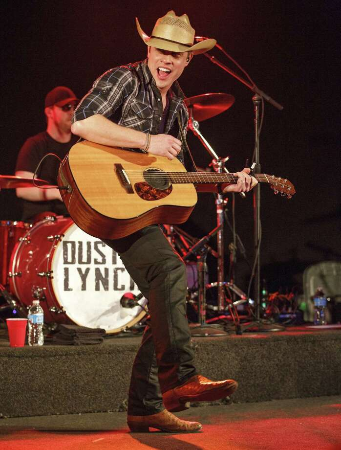 Dustin Lynch  takes to the stage Saturday after the rodeo, which begins at 1 p.m. Photo: Joey Foley, Getty Images / 2013 Joey Foley