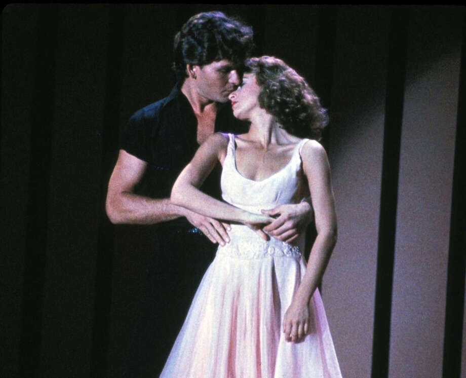 """FILE - In this image provided by Lionsgate Home Entertainment, Patrick Swayze, portraying Johnny Castle, and Jennifer Grey, portraying Baby Houseman, are shown in a scene from the film, """"Dirty Dancing."""" Lionsgate is set to produce a remake of the film directed by Kenny Ortega. (AP Photo/Lionsgate Home Entertainment) Photo: Anonymous, Associated Press / AP2008"""