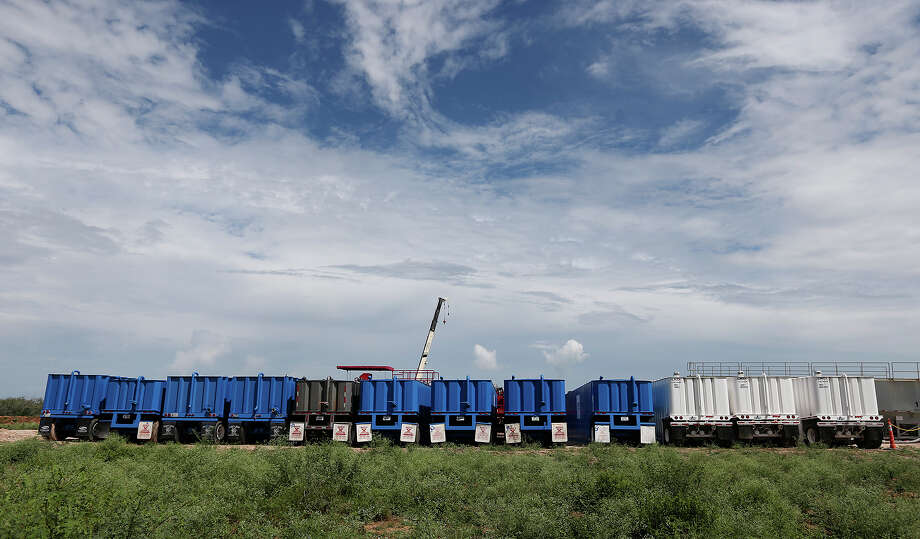 Truck trailers filled with fracturing material are lined up last September at a well on a ranch near the Jim Wells-Duvall County line. Photo: Jerry Lara, Staff / ©2013 San Antonio Express-News