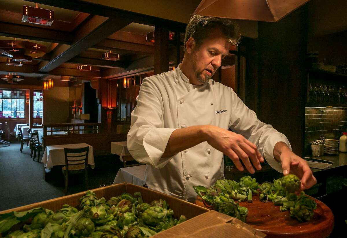 Cal Peternell cleans artichokes at Chez Panisse.