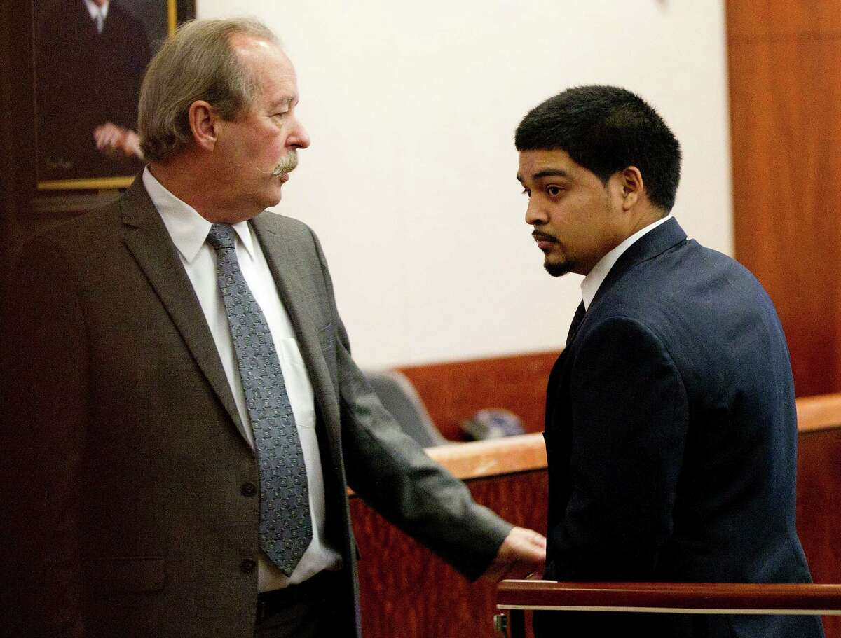Alfredo Gomez, 21, who is on trial for capital murder, walks into the courtroom next to his attorney Casey Keiman at the Harris County Criminal Justice Center Wednesday, Feb. 12, 2014, in . Gomez is the first suspect to go to trial in a bloody shootout that killed informant Lawrence Chapa, 53, on Nov. 21, 2011. Chapa, 53, was driving a tractor trailer loaded with marijuana from the border to the site of the sale, while being followed by Drug Enforcement Administration agents poised to arrest the buyers when a shootout