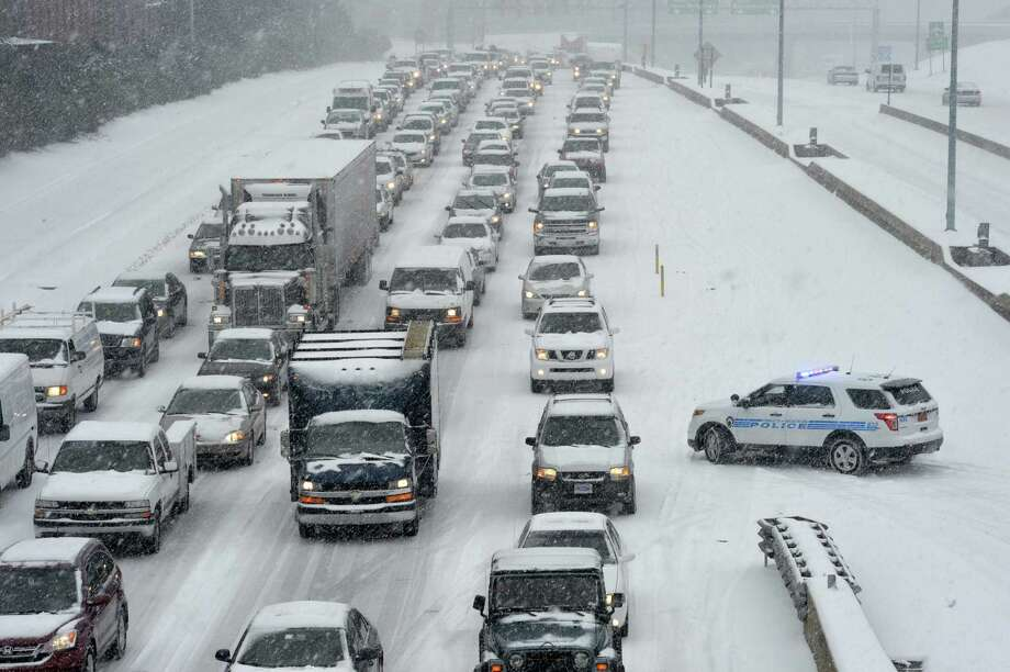 Traffic along Independence Boulevard near Hawthorne Lane crawls along the slick roadway as a winter storm hits   Wednesday, Feb. 12, 2014, in Charlotte, N.C. (AP Photo/The Charlotte Observer, Davie Hinshaw) MAGS OUT; TV OUT; NEWSPAPER INTERNET ONLY ORG XMIT: NCCHN204 Photo: Davie Hinshaw / The Charlotte Observer