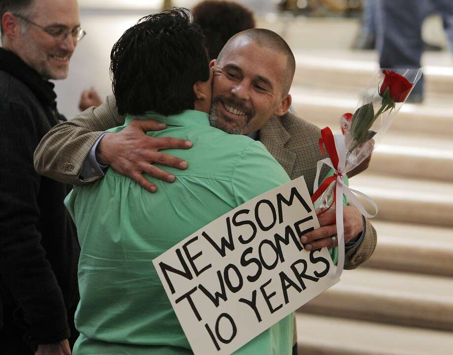 Frank Capley-Alfano hugs Laura Espinosa before a ceremony by same-sex marriage supporters gathered at City Hall to celebrate the 10th anniversary of same-sex weddings in San Francisco, Calif., on Wednesday, February 12, 2014. The action by then-Mayor Gavin Newsom paved the way for the legalization of same-sex wedding in many states across the nation. Photo: Carlos Avila Gonzalez, The Chronicle