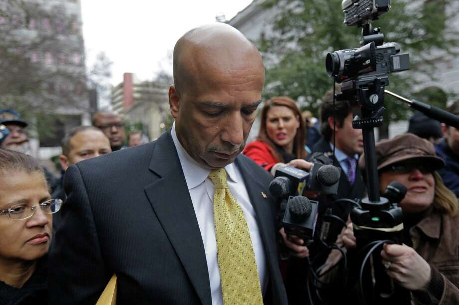 Former New Orleans Mayor Ray Nagin leaves federal court with his wife, Seletha, left, after his conviction on Wednesday on charges he accepted bribes and gratuities in exchange for helping firms get city contracts. Photo: Gerald Herbert, STF / AP