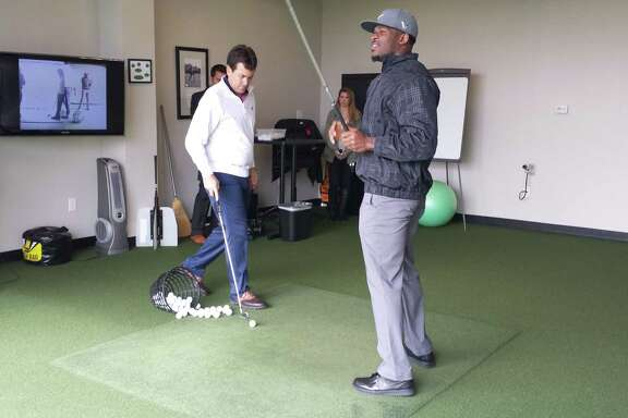 The wrist injury that kept Andre Johnson out of the Pro Bowl is behind him, and the Texans' star receiver, right, was working on his golf game at the Golf Club of Houston on Wednesday in preparation for his charity event March 10.