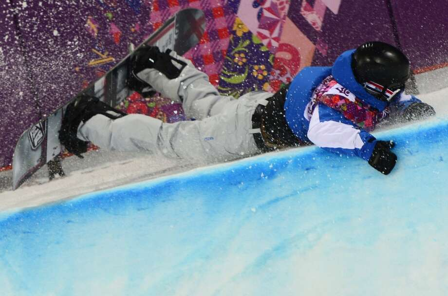 France's Johann Baisamy crashes in the Men's Snowboard Halfpipe Semifinals at the Rosa Khutor Extreme Park during the Sochi Winter Olympics on February 11, 2014.  (Javier Soriano/AFP/Getty Images) Photo: JAVIER SORIANO, AFP/Getty Images