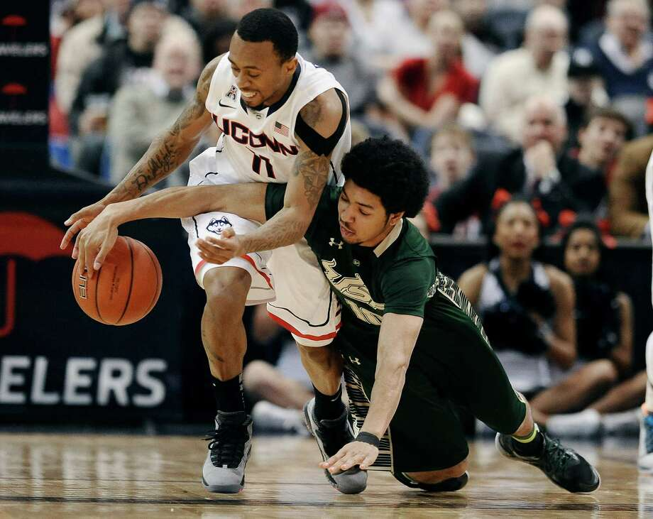 Connecticut's Ryan Boatright , left, steals the ball from South Florida's Josh Heath, right, during the first half of an NCAA college basketball game on Wednesday, Feb. 12, 2014, in Hartford, Conn. (AP Photo/Jessica Hill) Photo: Jessica Hill, Associated Press / Associated Press