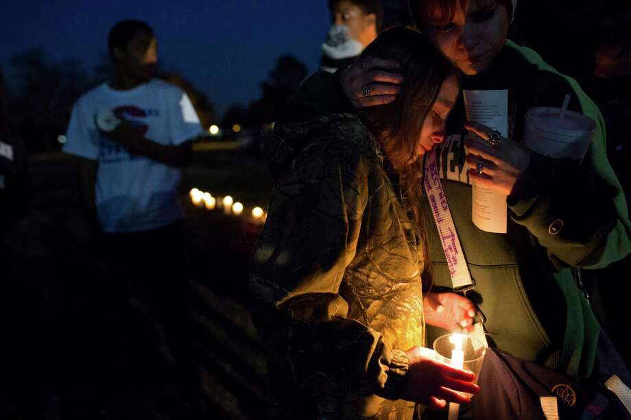 Annabelle Richard, 11, left, and Deschenes join supporters during the vigil in a park near the apartment complex where Cervantes' body was found. She was discovered in a vacant unit at The Bays Apartments on El Camino Real. Photo: Eric Kayne, For The Chronicle / Eric Kayne