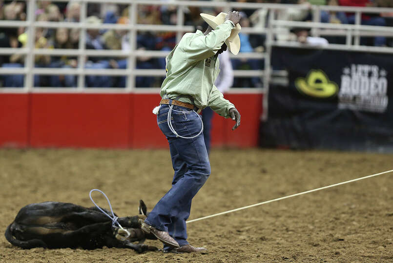 Fred Whitfield, of Hockley, Texas, is the first contestant in the Tie-Down Roping competition at the