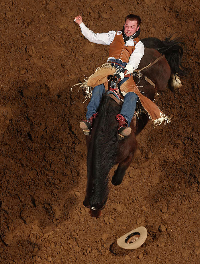 Kenny Haworth, of Terrebonne, Oregon competes in the Bareback Riding competition at the San Antonio Stock Show Rodeo at the AT&T Center, Wednesday, Feb. 12, 2014. Photo: Jerry Lara, San Antonio Express-News / ©2013 San Antonio Express-News