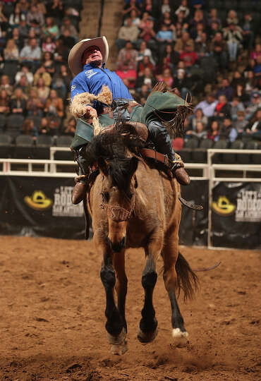 Heith Allan DeMoss, of Heflin, Louisiana, competes in the Saddle Bronc Riding competition at the San