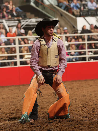 Ty Kirkland, of Lufkin, Texas, reacts after fall off early during the Saddle Bronc Riding competitio