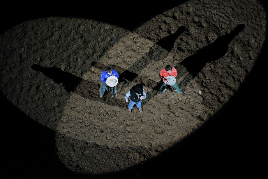 Announcer Hadley Barrett, center, leads the crowd in prayer during the Grand Entry at the start of the San Antonio Stock Show Rodeo at the AT&T Center, Wednesday, Feb. 12, 2014. Photo: Jerry Lara, San Antonio Express-News / ©2013 San Antonio Express-News