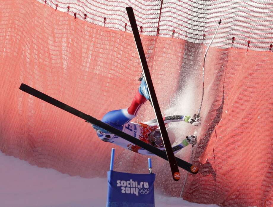 France's Marie Marchand-Arvier crashes into safety netting during the women's downhill at the Sochi 2014 Winter Olympics, Wednesday, Feb. 12, 2014, in Krasnaya Polyana, Russia. (AP Photo/Charles Krupa) Photo: AP