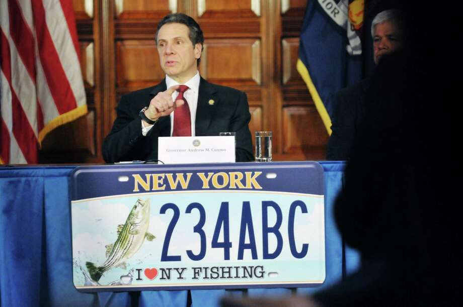 Governor Andrew Cuomo answers a reporter's question  during a press event at the Capitol on Wednesday, Feb. 12, 2014 in Albany, NY.  The event was held for the Governor to announce a new program where individuals can buy a  lifetime hunting, fishing and parks license.  Along with the lifetime license there are new themed license plates.      (Paul Buckowski / Times Union) Photo: Paul Buckowski / 00025741A