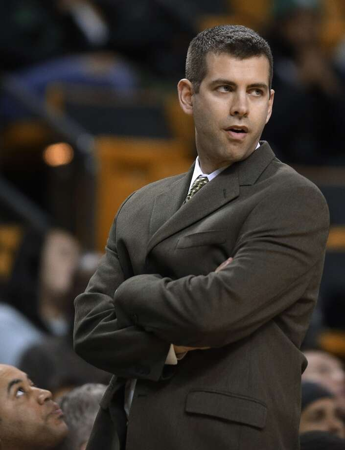 Boston Celtics coach Brad Stevens watches as his team plays defense against the San Antonio Spurs during the first half of an NBA basketball game in Boston, Wednesday, Feb. 12, 2014. (AP Photo/Stephan Savoia) Photo: Associated Press