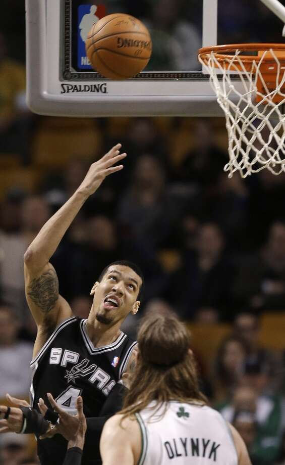 San Antonio Spurs  guard Danny Green (4) takes a shot as Boston Celtics center Kelly Olynyk (41) watches during the second half of an NBA basketball game in Boston, Wednesday, Feb. 12, 2014. The Spurs defeated the Celtics 104-92. (AP Photo/Stephan Savoia) Photo: Associated Press