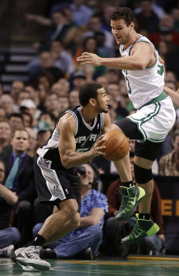 San Antonio Spurs guard Cory Joseph (5) looks to the basket as Boston Celtics center Kris Humphries (43) defends during the second half of an NBA basketball game in Boston, Wednesday, Feb. 12, 2014. The Spurs defeated the Celtics 104-92.(AP Photo/Stephan Savoia) Photo: Associated Press