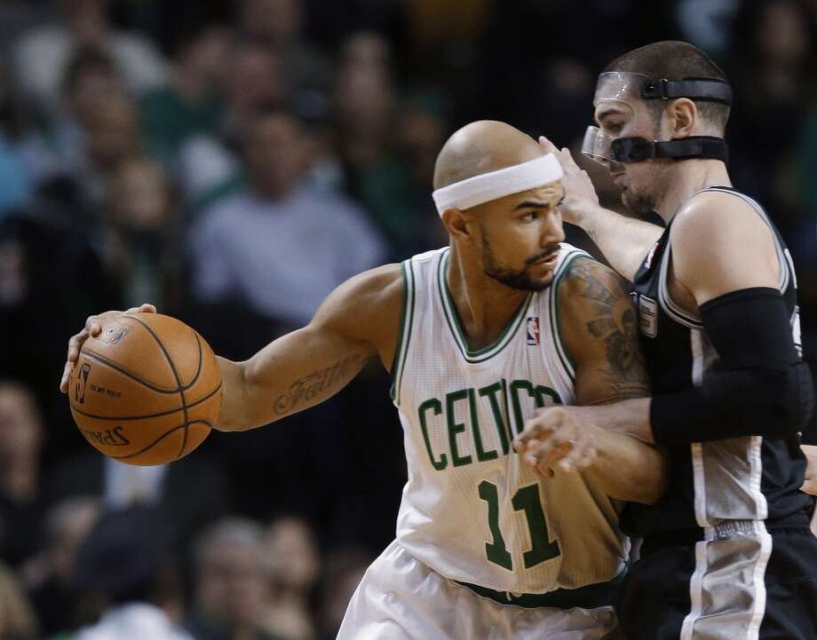 Boston Celtics guard Jerryd Bayless (11) attempts to drive around San Antonio Spurs point guard Nando de Colo during the first half of an NBA basketball game in Boston, Wednesday, Feb. 12, 2014. (AP Photo/Stephan Savoia) Photo: Associated Press