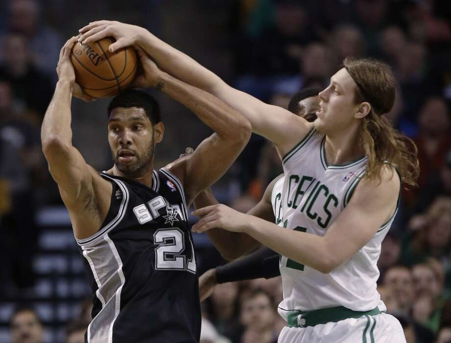 Boston Celtics center Kelly Olynyk, right, fouls San Antonio Spurs forward Tim Duncan (21) as Duncan comes down with the rebound during the second half of an NBA basketball game in Boston, Wednesday, Feb. 12, 2014. The Spurs defeated the Celtics 104-92. (AP Photo/Stephan Savoia) Photo: Associated Press