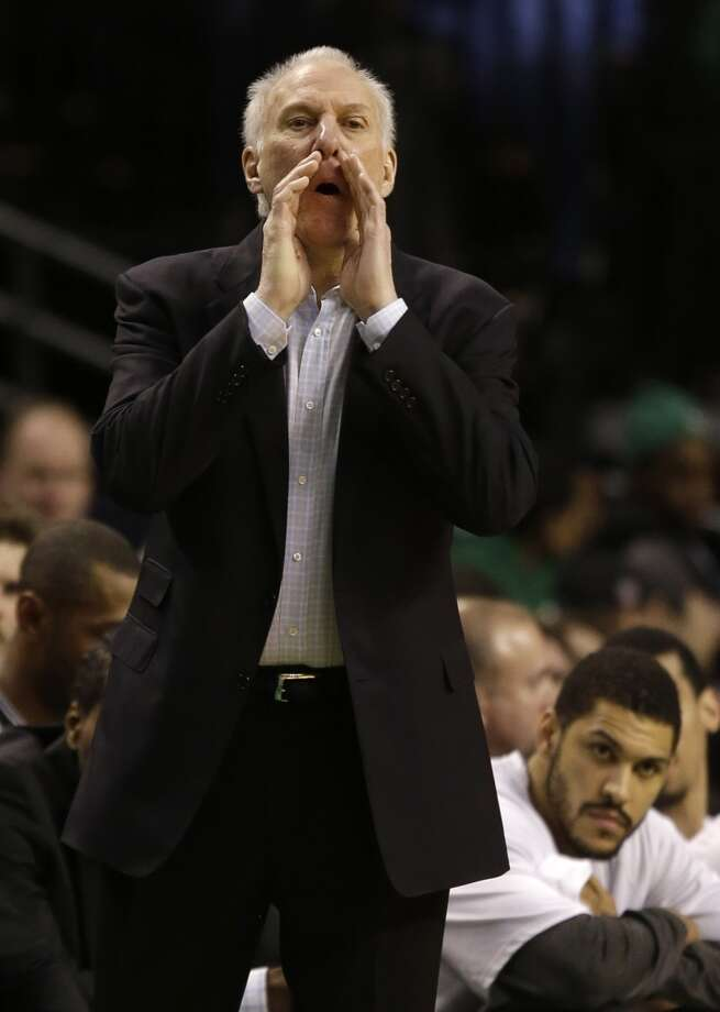 San Antonio Spurs coach Gregg Popovich shouts instructions to his team as they work their offense during the first half of an NBA basketball game against the Boston Celtics in Boston, Wednesday, Feb. 12, 2014. (AP Photo/Stephan Savoia) Photo: Associated Press