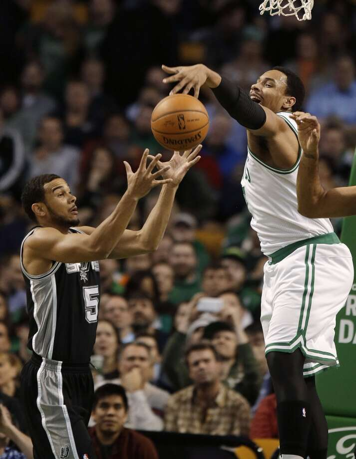 Boston Celtics center Jared Sullinger (7) can't hang on to an offensive rebound as the ball falls into the hands of San Antonio Spurs point guard Cory Joseph (5) during the first half of an NBA basketball game in Boston, Wednesday, Feb. 12, 2014. (AP Photo/Stephan Savoia) Photo: Associated Press