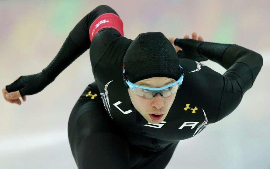 Katy's Jonathan Garcia gives it his best shot in a 1,000-meter speedskating race. Photo: Matt Dunham, STF / AP