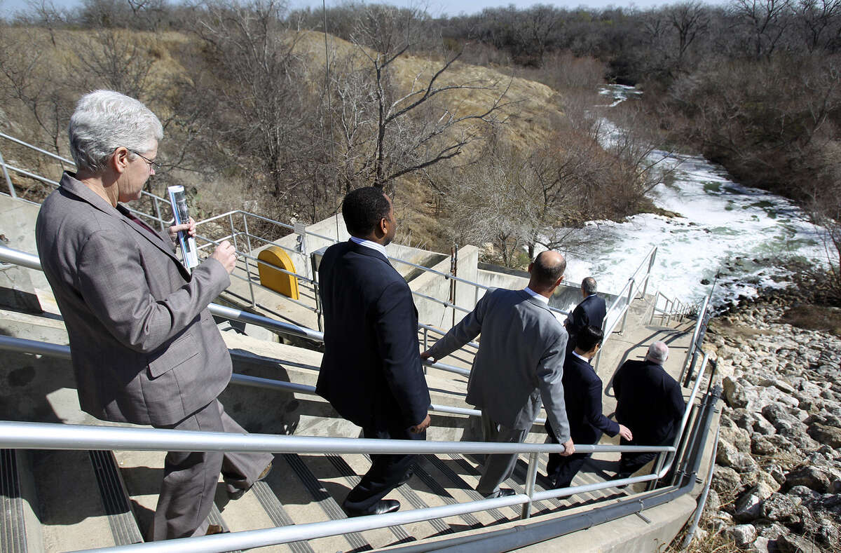 Environmental Protection Agency Administrator Gina McCarthy (left) follows officials to view the release of recycled water at the Dos Rios facility.