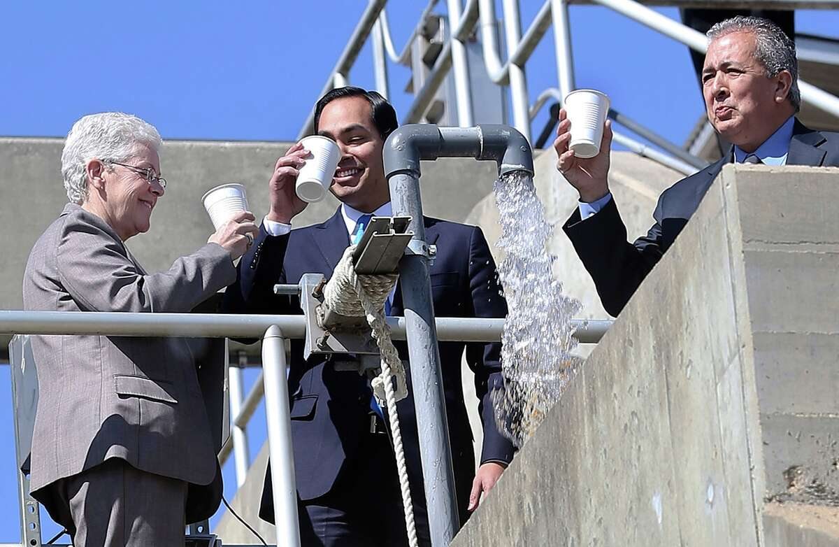 The mayor toasts a drink of clean water with SAWS CEO Robert Puente quenching his thirst as Environmental Protection Agency Administrator Gina McCarthy visits the Dos Rios Water and Recycling Center and Centennial Solar Farms with Mayor Julian Castro on February 12, 2014.