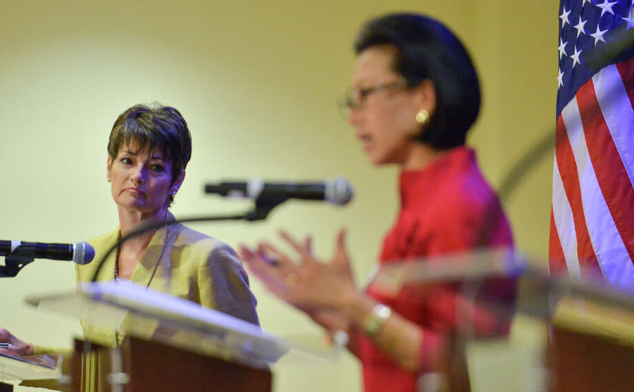 State Senator Donna Campbell (left) listens to former Councilwoman Elisa Chan during a Texas Senate District 25 candidate forum sponsored by the San Antonio Chamber of Commerce at the Marriott Riverwalk Wednesday. Photo: For The San Antonio Express-News
