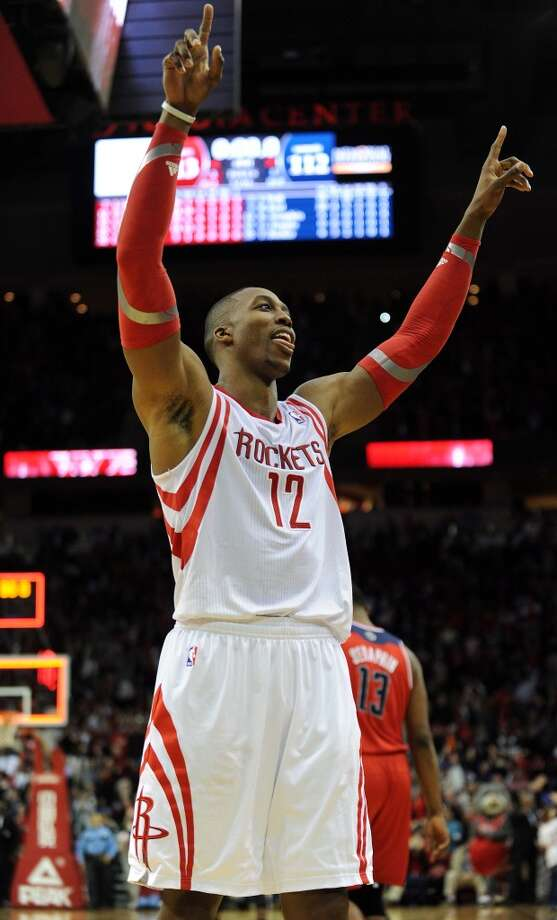Houston center Dwight Howard celebrates the Rockets' victory. Photo: Eric Christian Smith, For The Chronicle